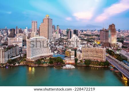 Bangkok Transportation at Dusk with Modern Business Building along the river (Thailand) #228472219