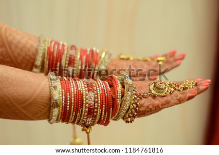 Bangles  is the perfect accessories . It has golden finish with stones. mostly  such kind of bangles wear in occasion   like in weddings or anyother events .  #1184761816