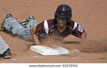 BANGOR, MAINE - AUGUST 18: Kenny Rhodes of Palm Bay, Florida slides safely back to first at the Senior League Baseball World Series against Tanauan City, Philippines August 18, 2011 in Bangor, Maine.