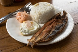 Bangsilog - Milk fish (bangus) served with garlic rice (sinangag), egg, and atchara (pickled green papaya)