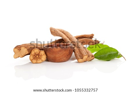 banisteriopsis caapi wood, psychotria leaves and ayahuasca brew in wooden bowl isolated on white background. Tradtional plant medicine. Contemporary style. Stock fotó ©