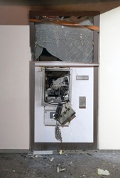 Bank assaulted by criminals they expel an ATM or Bancomat with explosives to steal cash contained in the security safe. External area for money withdrawal operations blown up with explosives.