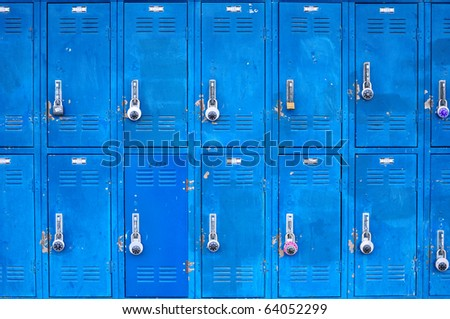 Bank of beat up blue school lockers