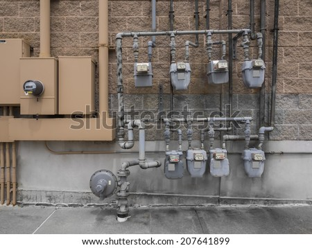 Shutterstock Bank of individual commercial natural gas meters on building exterior to measure  consumption
