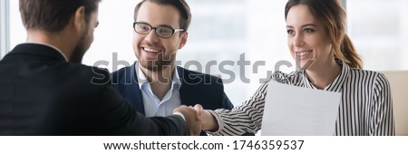 Bank workers and satisfied client make deal shake hands. Signing profitable contract entities business parties congratulates each other handshaking. Horizontal photo banner for website header design