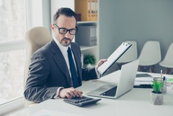 Banker broker man in formal wear sit on chair armchair behind desktop with modern technology in bright lite workplace office keeps economic records