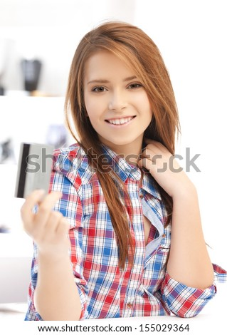 banking and shopping concept - happy teenage girl with credit card
