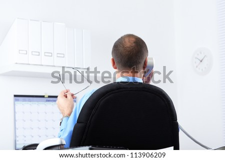 Banking. Businessman with telephone in the office