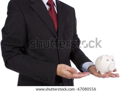 Banking concept - A businessman showing a piggy bank