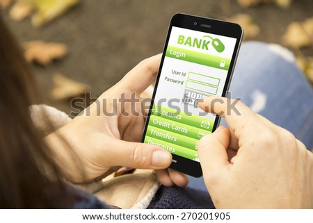 banking security concept: young woman with online banking application phone at the park