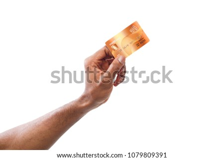 Banking services. Black male hand holding plastic credit card on white isolated studio background, copy space, cutout