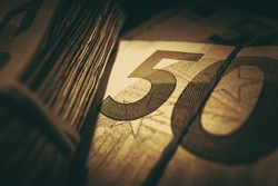 Banking Theme. Dark Sepia Color Grading Fifty 50 Euro Banknotes Cash Money Business and Economy Conceptual Photo.