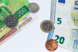 Banknotes and coins. Euros and roubles