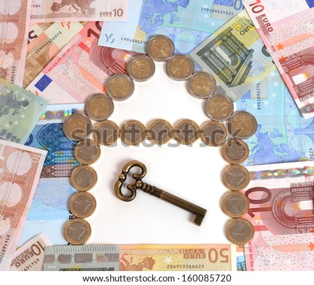 banknotes and coins in house shape with key concept for real state