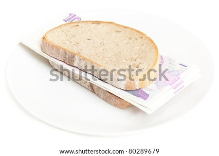Banknotes between two slices of bread.