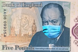 banknotes 5 British pounds with Winston Churchill in a medical mask. of the coronavirus epidemic in the UK .the impact of the coronavirus epidemic on the UK economy the .devaluation of the UK currency