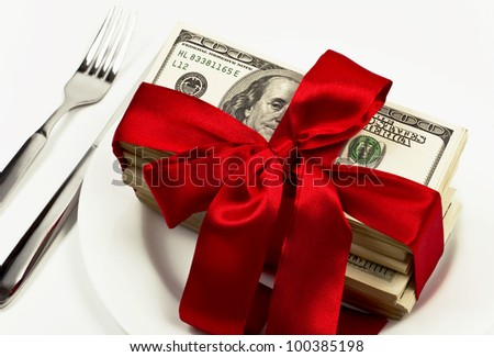 banknotes combined and tied up by red bow on white background