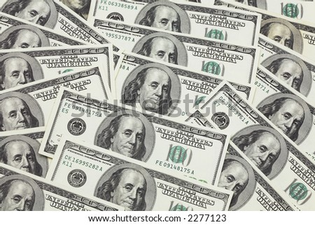 Banknotes in 100 US dollars have put the friend on the friend and have made a background of money