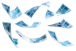 banknotes of 100 reais of brazil falling on isolated white background. Grand prize, lottery or wealth concept.