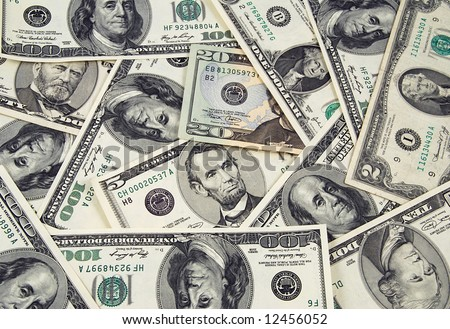 Banknotes of United States of America - dollars - ona one heap. There are all included - 100, 50, 20, 10, 2 and a 1 dollar bills in this money background