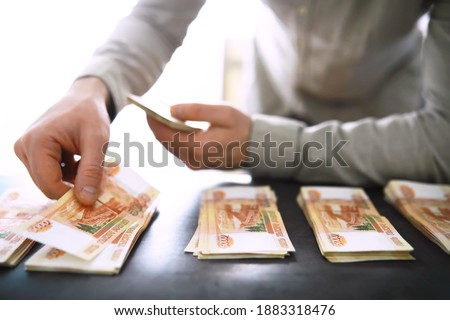 """Banknotes with inscription """"five thousand rubles"""". Russian money face value of five thousand rubles. Close-up of Russian rubles . The concept of Finance.Background and texture of money"""