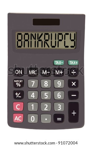 bankrupcy on display of an old calculator on white background