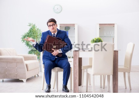 Bankrupt businessman angry and upset at home Stock photo ©