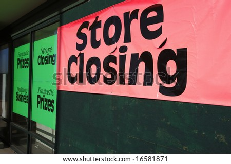Bankrupt store with closeout signs.
