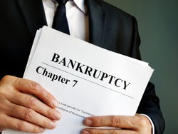 Bankruptcy Chapter 7 documents in the hands.