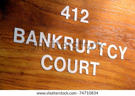 Bankruptcy court sign outside an insolvency case resolution and judgment chamber in a courthouse