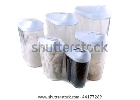 Banks with spices and groats on kitchen on a white background