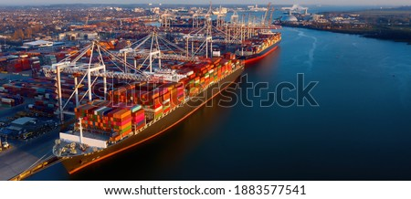 Banner - Aerial view of colorful containers on cargo ships at the port of Southampton, which is one of the Leading Port Terminal Operators in the UK. Space for text. ストックフォト ©
