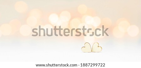 Banner. Background for Valentine's Day. two hearts with festive bokeh lights in the background. happy lovers day party invitation card layout, copy space.