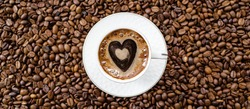 Banner.Cafes and restaurants. A mug of invigorating, black coffee with heart shaped foam and coffee beans in a bag on a white background. Place for an inscription. The concept of hot drinks and love.