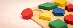 Banner closeup of colorful wooden Montessori sensorial material learning, Shape and color block. Kindergarten educational toys, Thinking process, Cognitive skills, Learn Through Play tools concept.