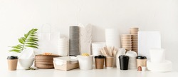 Banner. Eco friendly disposable tableware and eating utensils on table