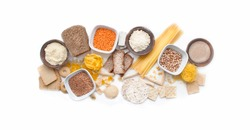 Banner gluten free set. Gluten free food. Various gluten free pasta, bread, snacks and flour, top view. Grains of corn.