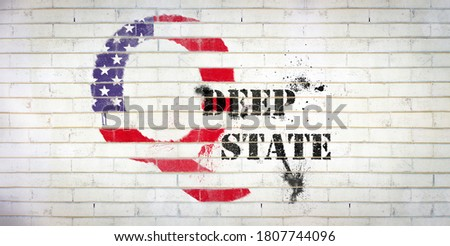 Banner heading Qanon graffiti sprayed on white wall with Deep State text, copy space, conspiracy theory, deep state conservative concept