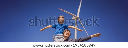 BANNER, LONG FORMAT Alternative energy, wind farm and happy time with your family. Happy father carrying his son on shoulders is on vacation and escape to nature. Father carrying son on shoulders and
