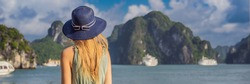 BANNER, LONG FORMAT Attractive woman in a dress is traveling in Halong Bay. Vietnam. Travel to Asia, happiness emotion, summer holiday concept. Picturesque sea landscape. Ha Long Bay, Vietnam
