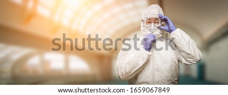 Banner of Male Chinese Doctor or Nurse Wearing Protective Face Mask and Surgical Gloves In Hospital.