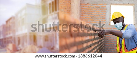 Banner of Professional engineer check bricklayer at construction site for building house which install bricks by a worker. Architect measures masonry bricks layer, cement with industrial standard  ストックフォト ©