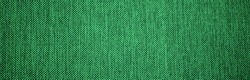 Banner of texture of green natural linen fabric. St Patricks Day abstract wallpaper. Used like background.