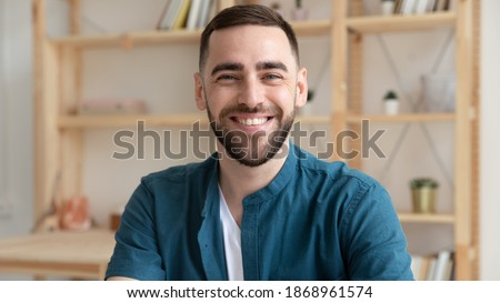 Banner panoramic view of smiling Caucasian male employee have video call or webcam digital virtual conference at workplace. Headshot portrait of happy businessman at workplace. Employment concept.