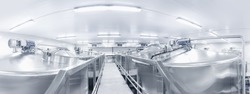 Banner plant milk factory industry. Stainless steel storage and processing tanks.