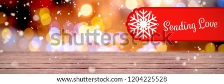 Banner sending love against defocused of christmas tree lights and fireplace #1204225528
