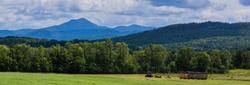 banner showing haying the fields  with view of Camels Hump Mountain , Green Mountains of Vermont  banner showing haying the fields  with view of Camels Hump Mountain , Green Mountains of Vermont