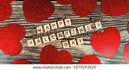 Banner. Valentine's Day. happy valentine's day inscription with red hearts on wooden background. The concept of celebration and love.