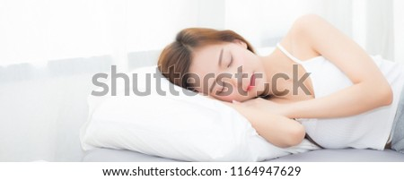 Banner website beautiful asian young woman sleeping lying in bed with head on pillow comfortable and happy. girl with relax for health concept.