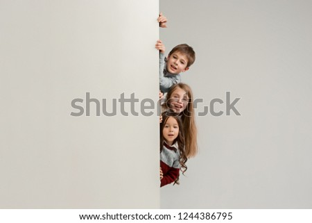 bdaf4df14d7c Banner with a surprised children peeking at the edge with copyspace. The  portrait of cute